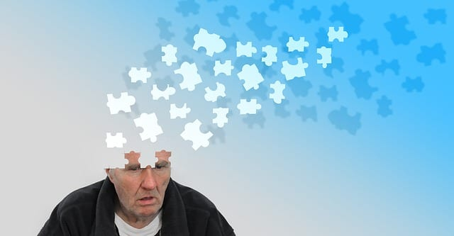 old man with puzzle out of head