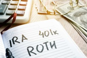 words ira 401k roth handwritten in a note retirement plans