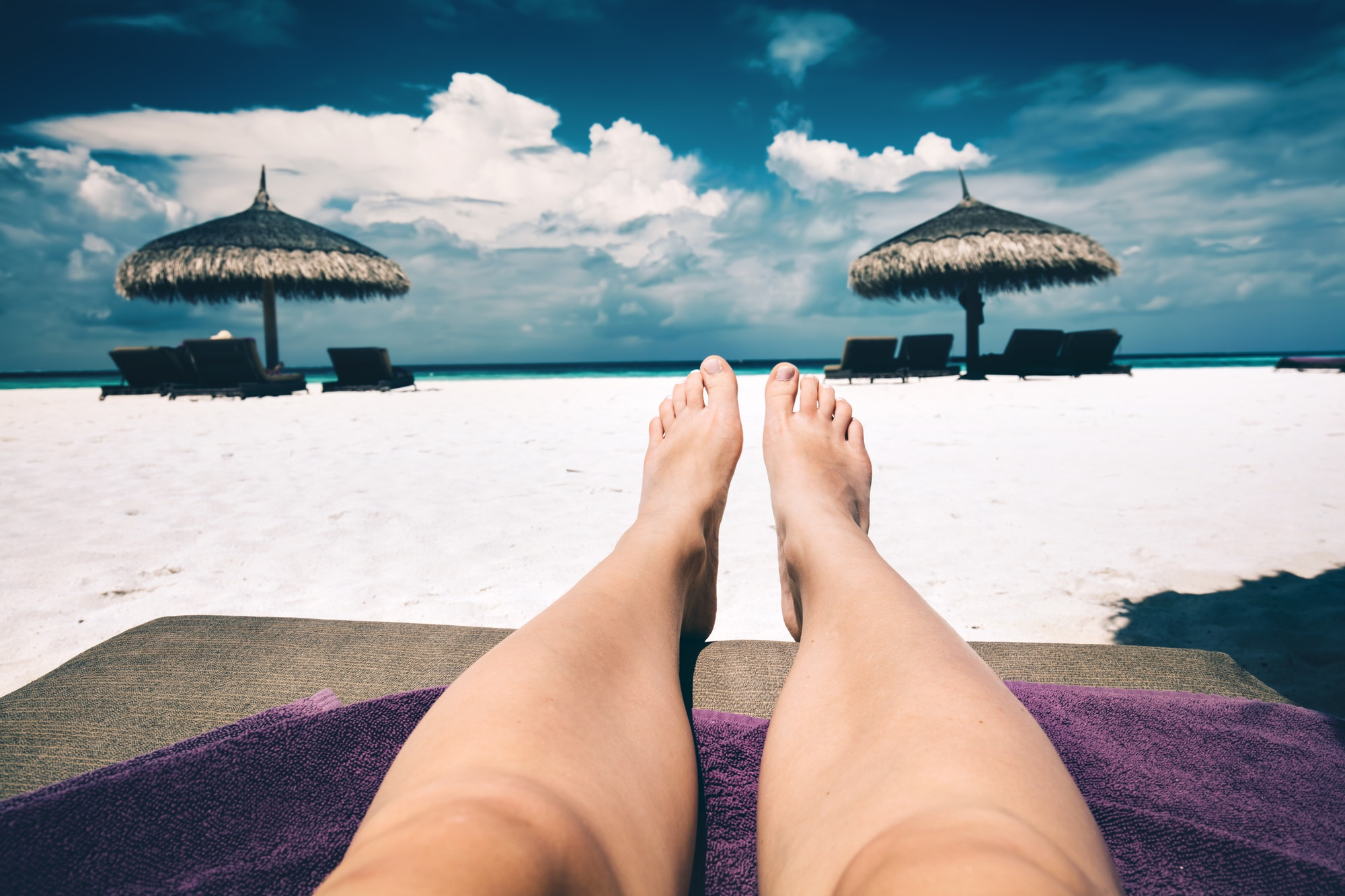 Resting on a beach. First person view. Maldives